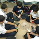 Boys playing Beyblade