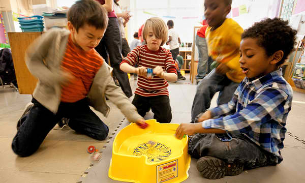 Children playing Beyblade games